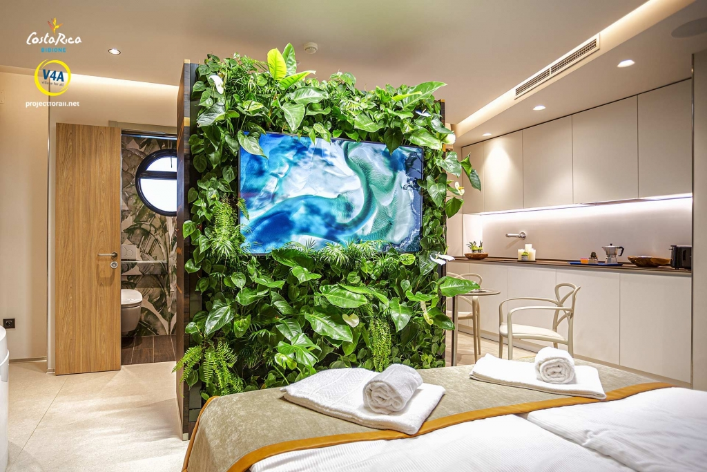 Panoramica interna Suite Accessibile dal letto vista sul bosco verticale con tv inserita