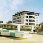 Dalla spiaggia attrezzata la vista dell'Hotel Blu Suite di Bellaria a lavori finiti con entrambe gli edifici realizzati. In primo piano un area di seduta sulla spiaggia e persone a passeggio