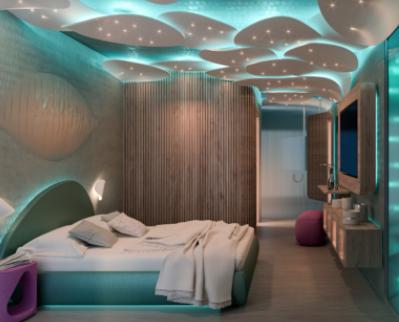 Camera con letto in primo piano ambientata di giorno